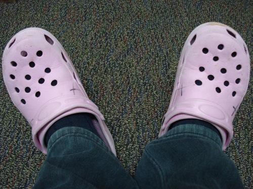 Adino in pink Crocs