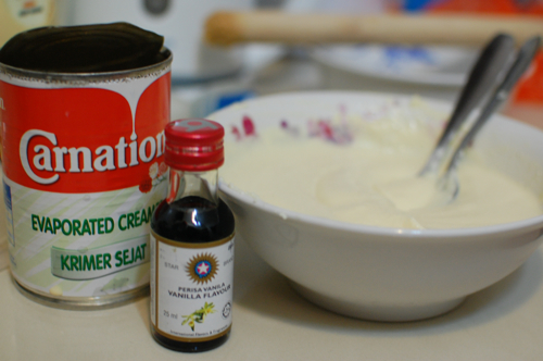 Making cheese cake - add milk and vanilla essence